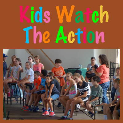 kids watch the action